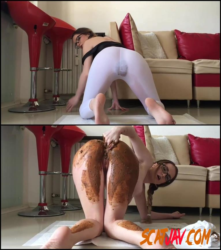 The girl stands doggy style and poop in sexy fishnet tights